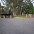 Picnic shelter and vault toilet facility at Hosmer Grove Campground.- Hosmer Grove Campground