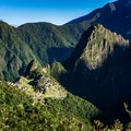 After descending a bit from the sun gate, sweeping views of Machu Picchu and her surrounding mountains grace the skyline.- Machu Picchu via the Inca Trail