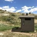 Vault toilet.- Wannagan Campground