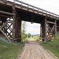 A trestle over the trail.- The Rail Trail