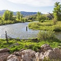 Fisherman in the Weber River.- The Rail Trail