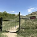 The gate entrance into Theodore Roosevelt National Park.- Petrified Forest Loop Trail