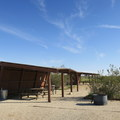 Ramadas provide protection from sun and wind at the Saddleback Butte campground.- Saddleback Butte State Park