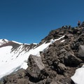 The ascent to the summit of Diamond Peak.- Diamond Peak: Pioneer Gulch/Southwest Ridge