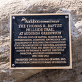 A plaque commemorating the Thomas R. Baptist Hillside Trail.- Greenwich Audubon
