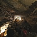 Listening to a park ranger describing the cave formations.- Mammoth Cave National Park