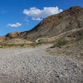 A rocky access road makes up the hike, which is about 4.2 miles round trip.- Frenchman Mountain