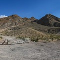 Parking is at the wide turnout along East Lake Mead Boulevard, where the trail begins behind a gate.- Frenchman Mountain