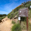 A sign marks the intersection with the trail that starts at the Highland Drive Trailhead.- Bishop Peak via Foothill Boulevard