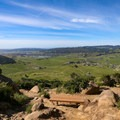 A bench sits atop Bishop Peak. Adventurous hikers can climb the boulders from here.- Bishop Peak via Highland Drive