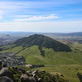 View of Cerro San Luis, one of the Nine Sisters, with Pismo and Guadalupe beaches behind.- Bishop Peak via Highland Drive