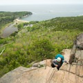 A final climb with great views of Sand Beach in the background.- The Beehive Loop Trail