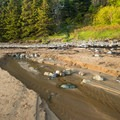 A small streambed on the eastern edge of the beach.- Sand Beach
