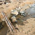 A wood bridge over the stream.- Sand Beach