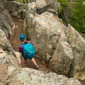 The Cadillac Cliff Trail winds through a narrow passage.- Gorham Mountain Trail