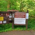 Pay station and informational plaque in the center of the campground.- Alder Glen Recreation Site