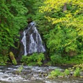 An unnamed seasonal waterfall pours into the Nestucca River.- Alder Glen Recreation Site