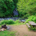 View of the waterfall from a campsite.- Alder Glen Recreation Site
