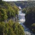 The view of the Portage Viaduct Railroad Bridge over Upper Falls, Middle Falls, and the Genesee River from Inspiration Point.- Letchworth West Gorge Trail
