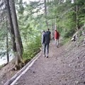 Hiking along the trail between campsites.- Packwood Lake