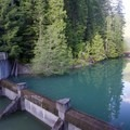 The hydraulic dam with a view of the walking bridge.- Packwood Lake