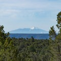 The San Fransisco Peaks near Flagstaff, with elevations exceeding 12,000 feet, seen from near the Rim Trail.- Rim Trail