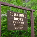 The trailhead sign points the way.- Sculptured Rocks Natural Area