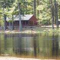 The Oak Lodge across the pond.- Schreeder Pond
