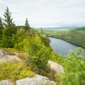 Looking out at Echo Lake from the top of Beech Cliffs.- Beech Cliff Trail