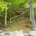 Optional stairs leading down from the parking area.- Echo Lake Beach