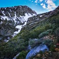 At about 8,300 feet, the terrain shifts and dramatic views of Eastern Sierra cliffs come into focus.- Red Lake