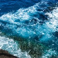 The ocean below can be tumultuous, so check weather conditions.- Spitting Cave
