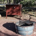 Heavy duty fire rings with grills and bear boxes for food storage.- Rock Crossings Campground