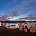Guests enjoying a waterfront fire pit.- Alderbrook Resort + Spa
