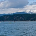 Paddling in front of the Olympic Mountains.- Alderbrook Resort + Spa