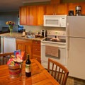 A cottage kitchen.- Alderbrook Resort + Spa