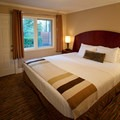 A cottage bedroom.- Alderbrook Resort + Spa