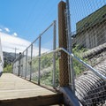 A wooden footbridge over the powerhouse flumes, which enabled public access to this area.- Tahoe-Pyramid Bikeway: Farad to Floriston