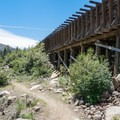 The trail passes an old wooden flume that once fed to the hydroelectric powerhouse.- Tahoe-Pyramid Bikeway: Farad to Floriston