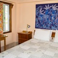 Typical bedroom in a suite.- Colinda Cabanas