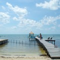 Private dock with deck chairs and hammocks for guests.- Colinda Cabanas