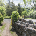 A stone wall leads to the trailhead.- The Long Path: Gonzaga Park to Schunemunk State Park