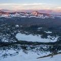 Skiing down Bald Mountain at sunset.- Bald Mountain Backcountry Ski