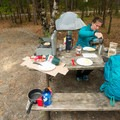 Picnic tables help with meal preparations.- Blackwoods Campround