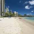 Waikīkī Beach's west end at Kahanamoku Beach with the iconic Hilton Hawaiian Village at far left.- Waikīkī Beach