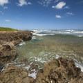 The basaltic shoreline at Kaiaka Bay Beach Park and campground.- Kaiaka Bay Beach Park + Campground