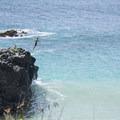 The jumping rock at Waimea Bay Beach.- Waimea Bay Beach Park