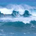 Big-wave riders tackling Waimea Bay in January. Photo by Anthony Quintano (CC 2.0).- Waimea Bay Beach Park