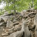 Follow the arrows around the boulders.- Breakneck Ridge