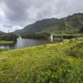 View of the Nu'uanu Reservoir dam en route to Lulumahu Falls.- Lulumahu Falls Hike